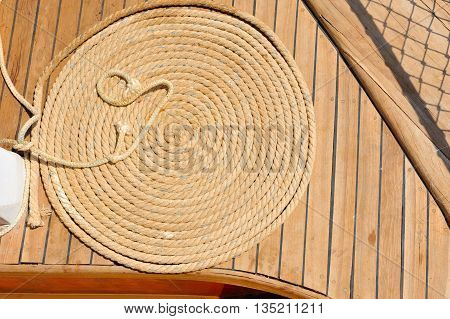 Ship Ropes On A Wooden Boat Deck