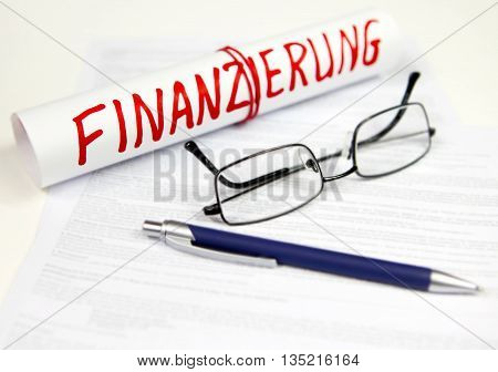 glasses and paper roll with the inscription finance