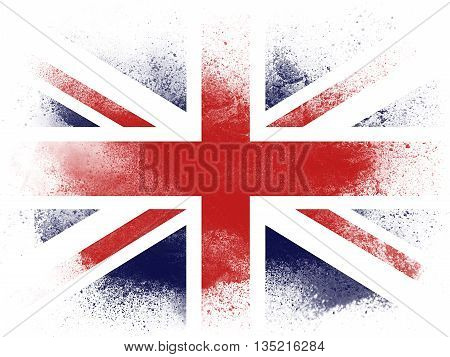 Powder paint exploding in colors of United Kingdom flag isolated on white background. Abstract particles explosion of colorful dust.
