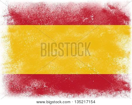 Powder paint exploding in colors of Spain flag isolated on white background. Abstract particles explosion of colorful dust.