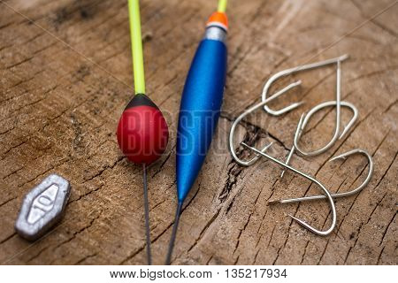 Fishing Gear On Wooden Background Closeup