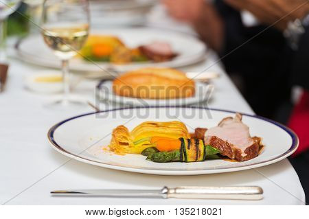 Veal with grilled vegetables in restaurant. Table setting