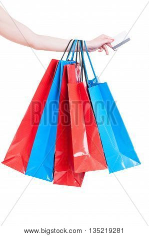Hand Holding Shopping Bags And Credit Card Isolated On White