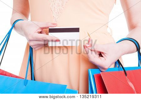 Close-up Of Woman Holding Card And Making Spending Gesture