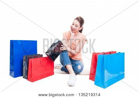 Woman Looking Into Gift Or Shopping Bag And Feeling Amazed