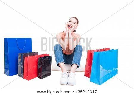 Young Lady Sitting With Shopping Bags Around And Feeling Cheerful