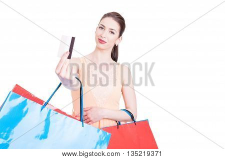 Pretty Lady Shopper Showing Credit Card And Smiling