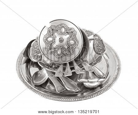 vintage old silverware in a silver tray isolated over white