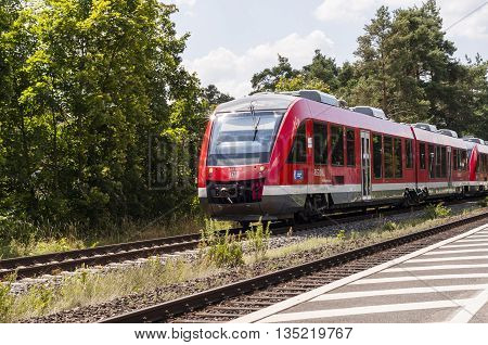 NURNBERG /GERMANY - JULY 17th 2014: photo of a commute train passing through a station in Nurnberg, Germany