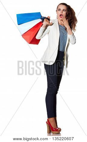 Surprised Young Woman With Shopping Bags On White Background