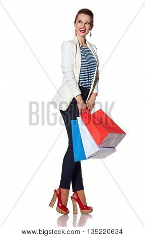 Excited Young Woman With Shopping Bags Looking On Copy Space