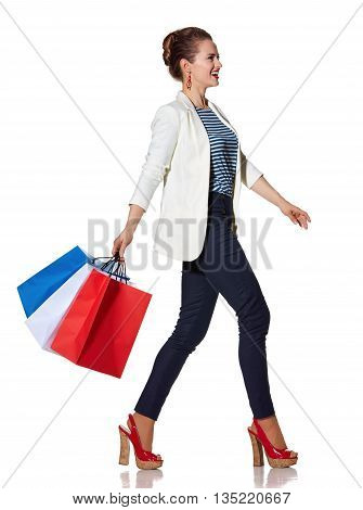 Happy Woman With French Flag Colours Shopping Bags Going To Side