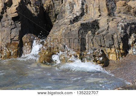 Tide and rock formations at Point Lobos State Preserve in Carmel, California, U.S.A.