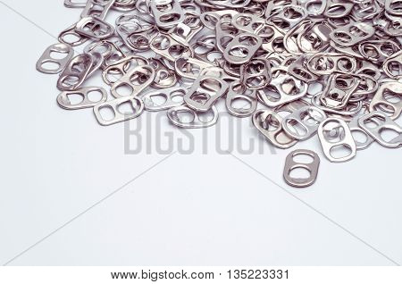 Aluminum ring pulls many white background. And space