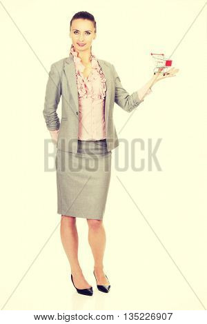 Businesswoman with shopping cart.