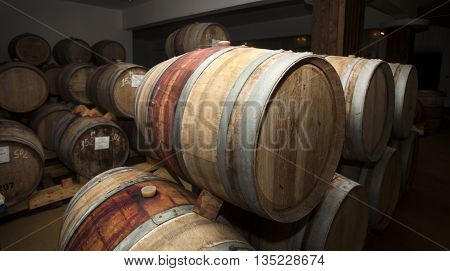 Wine Barrels In Cellar.