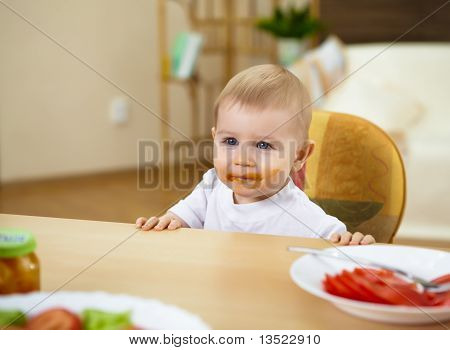 little boy having meal
