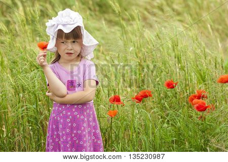 Little displeased and dissatisfied cute girl with red flower