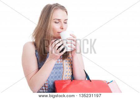 Beautiful Woman Shopper Enjoying The Smell Of A Fresh Coffee
