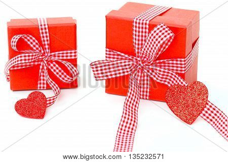 Two red gifts with grind and hearts on white background