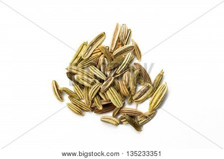 Heap of fennel seed isolated on white background view from above closeup.