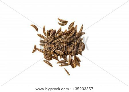 Heap of caraway seed isolated on white background view from above closeup.