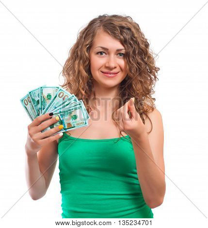 Smilling curly young woman holding cash. Isolated on white background