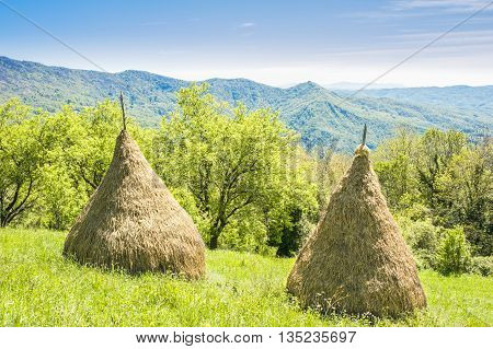 Traditional haystack of mountain villages in Italian Alps.
