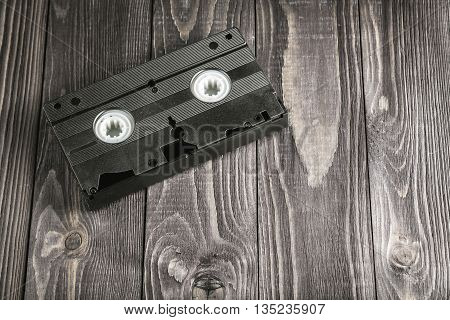 Videotape Cassette On Wooden Rustic Background