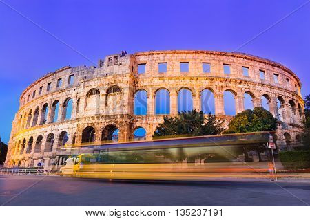 The Roman Amphitheater of Pula, Croatia shot at dusk. It is among the six largest surviving Roman arenas in the World and best preserved ancient monument in Croatia.