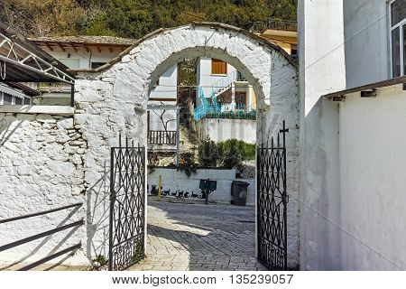 Old house and entrance of church in Panagia village, Thassos island,  East Macedonia and Thrace, Greece