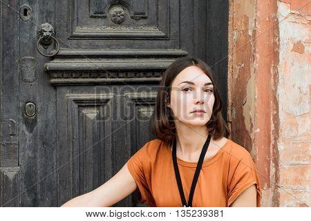 Beautiful girl in a boho dress posing in the street, street fashion