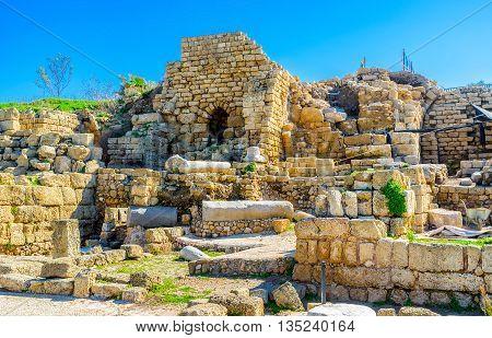 The Roman Period stone ruins of the villas public buildings and city streets in Caesaria Maritima Israel.