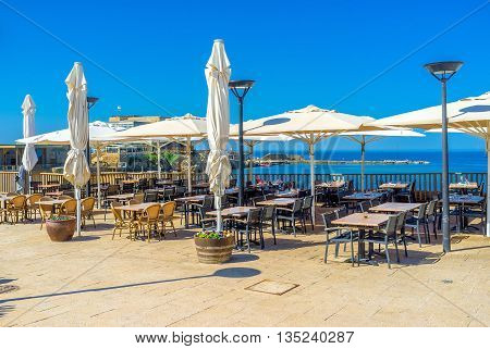 The beautiful outdoor cafe located next to the old harbor of Caesaria archaeological site Israel.
