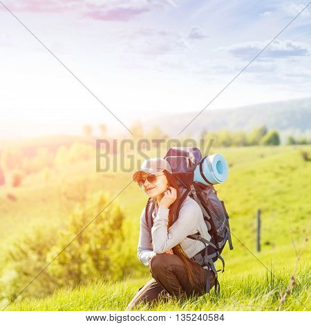 Young Happy Woman With Backpack Resting On Hill