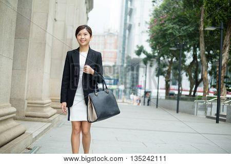 Asian Businesswoman walking at street