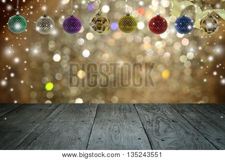 Christmas background and christmas ball with empty wooden deck table over winter bokeh