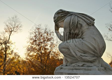 Cemetery Statue Of Mary At Sunset