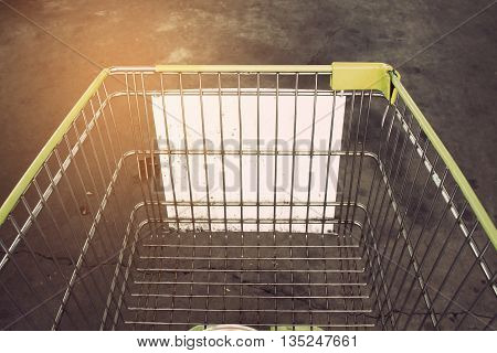 Shopping cart in Supermarket Aisle and Shelves