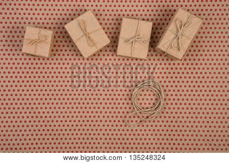 Gift  Boxes  Handmade Collection Of Craft Paper With Rope On Craft  Paper Background In Red Polka Do