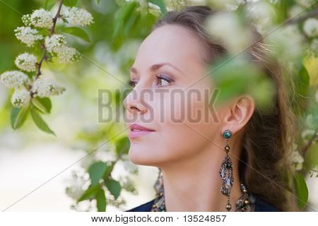 Beautiful Woman Among Blossoming Trees.