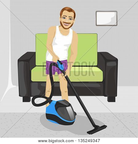 Full length of young man in underwear cleaning carpet with vacuum cleaner at home