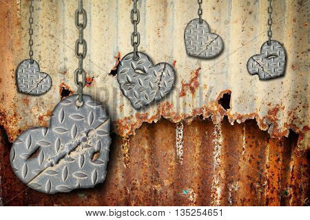 background hearts of steel with scratches hanging on chains