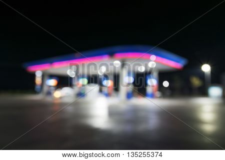Burred of lighting as night in a lonely petrol station.