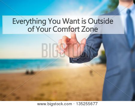 Everything You Want Is Outside Of Your Comfort Zone - Businessman Hand Pressing Button On Touch Scre