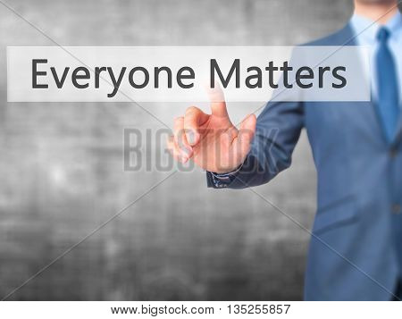 Everyone Matters - Businessman Hand Pressing Button On Touch Screen Interface.