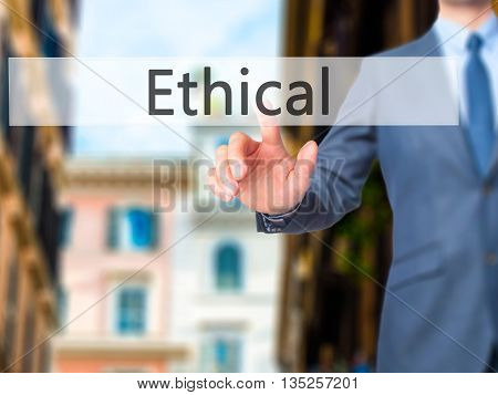 Ethical - Businessman Hand Pressing Button On Touch Screen Interface.