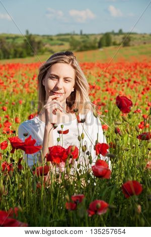 Young Girl In The Poppy Field