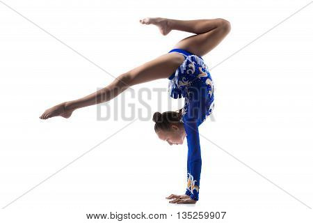 Teenage Acrobat Girl Doing Handstand