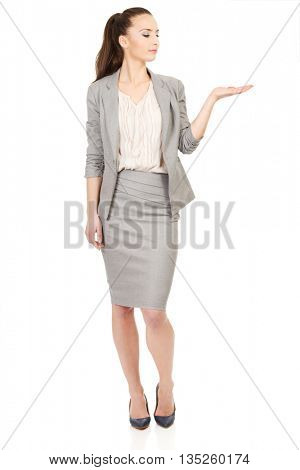 Businesswoman showing empty hand.